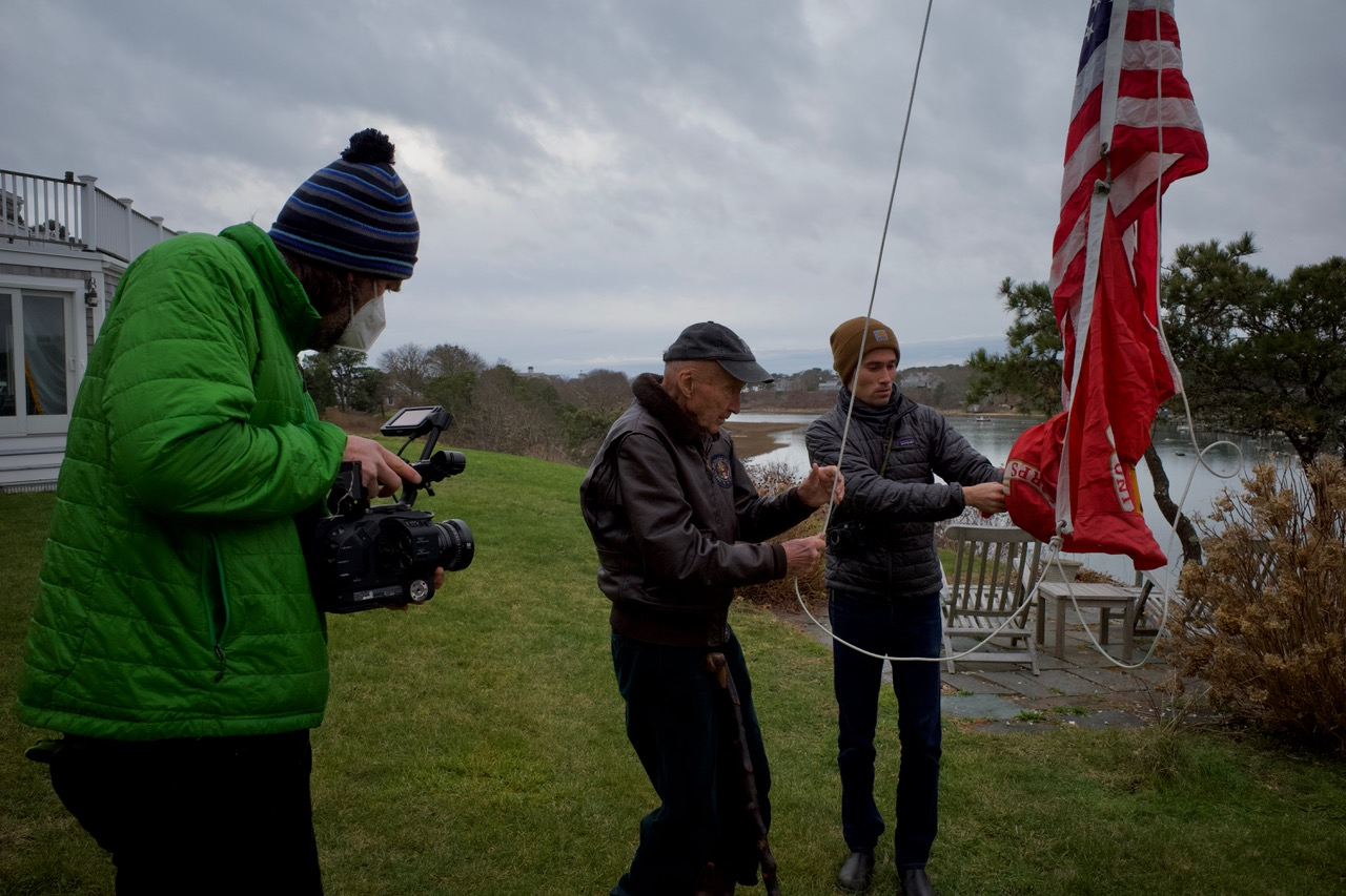 Chuck Daly and his son charlie raise the American and Marine Corps flags